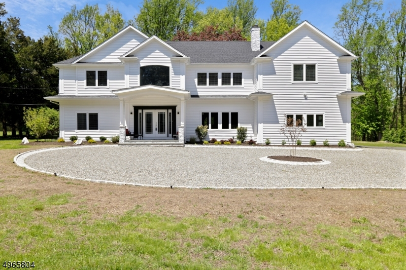 Contemporary Colonial, open floor plan, 4-5 BR's, 6 full baths, high ceilings, Spectacular high end EIK, BR's /ensuite baths, FR on second level, 1.7 acre level lot, privacy Quality construction with high end appliances ( Sub Zero, Wolf ) and features throughout home. Oversize BR's,Media, Fitness, & Entertainment rooms, 2 wet Bars, 2 laundry rooms - LL & second level