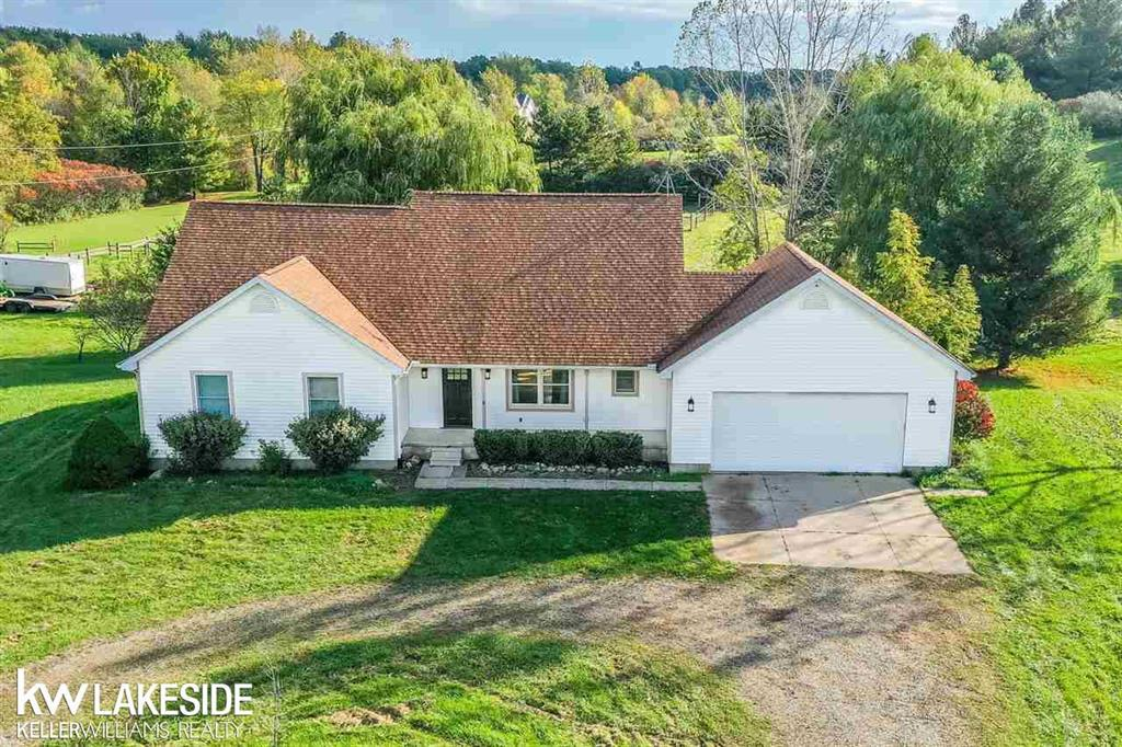 Welcome home to this sprawling, 4 bedroom, 1,800 sq. ft. ranch in Dryden Twp! Located on over 5 acres of land, this home is prefect for any horse/animal enthusiast. The horse barn on the back of the property features 3 large stalls, 1 grooming stall, a large tack room for lots of hay storage. Beyond the barn, there is a massive 80 x 120 outdoor arena, and  3 large pastures for any kind of trainer or grooming you wish. Inside the home, the entry level has been 100% remodeled with granite counters, vaulted ceilings ceramic tile, subway tile, recessed lighting, and farmhouse sink in the kitchen. Brand new carpet in all the bedrooms, master bathroom complete with stand up shower and jacuzzi tub. Walkout basement is partially finished, new furnace 2019, new water filtration system, well & septic passed inspection November 2019. Large deck overlooking the landscape. Across the street from the football stadium. All appliances included, keys at closing!