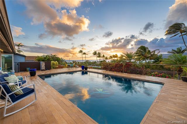 Rare single-level residence with views, pool and an indoor-outdoor floor plan perfect for island living! Thoughtfully remodeled with the help of J.A. Schmit, AIA, the combined dining, kitchen and family room open straight onto the deck with custom-tiled pool set against ocean, Diamond Head, sunset, mountain and city views.  Currently a spacious 4 bedroom home, with the flexibility of converting 2 separate offices to additional bedrooms if needed.  Private master suite includes a walk-in closet and bath with walk-in shower that opens to a private garden area.  Other features include PV (owned), split AC's in all of the bedrooms, laundry room, pantry, ample parking, trellised lanai for alfresco dining, and much more! Close to beaches, surf, shopping, dining, hiking and much more!