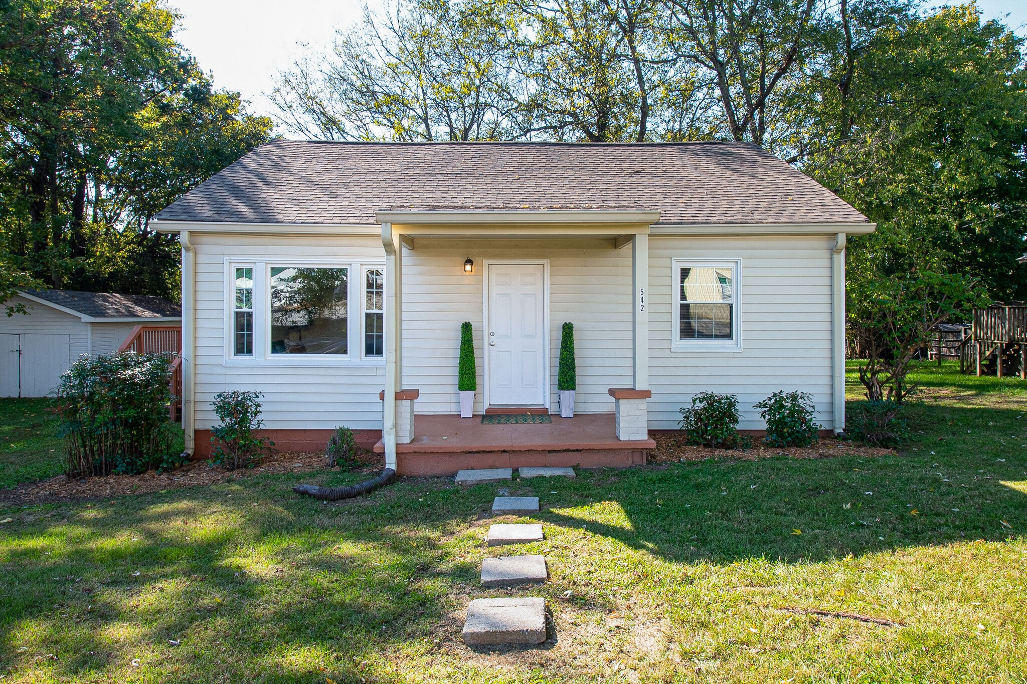Fantastic renovated home close to all that Gallatin has to offer. Generous sized living room drenched in sunlight - open style kitchen to eat-in area, and a HUGE backyard that is begging for a bonfire and a hammock! All appliances remain.