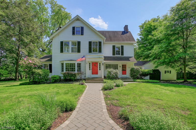 Sun filled colonial farmhouse with vintage character, modern conveniences, and tremendous space! A stunning private yard complete with Koi pond and a pergola surround it! 9 ft ceilings top the 1st fl including a huge Living Rm with wide plank floors & a wood fireplace along with a Dining Rm big enough to host everyone & French Doors to easily move the fun outdoors. The Kitchen is perfect for any meal with stainless appliances, Corian topped cabinets, & a fireplace. A cozy Sun/Family Rm with brick accent wall and enclosed Breezeway with Mud Rm & exercise area round out the 1st fl. 3 BRs on the 2nd fl and 2 BRs on the 3rd fl with a brand new Bathrm offer flexibility for space usage! Wide plank floors, built-in shelving, oversized windows, charming details, and a home warranty for peace of mind!