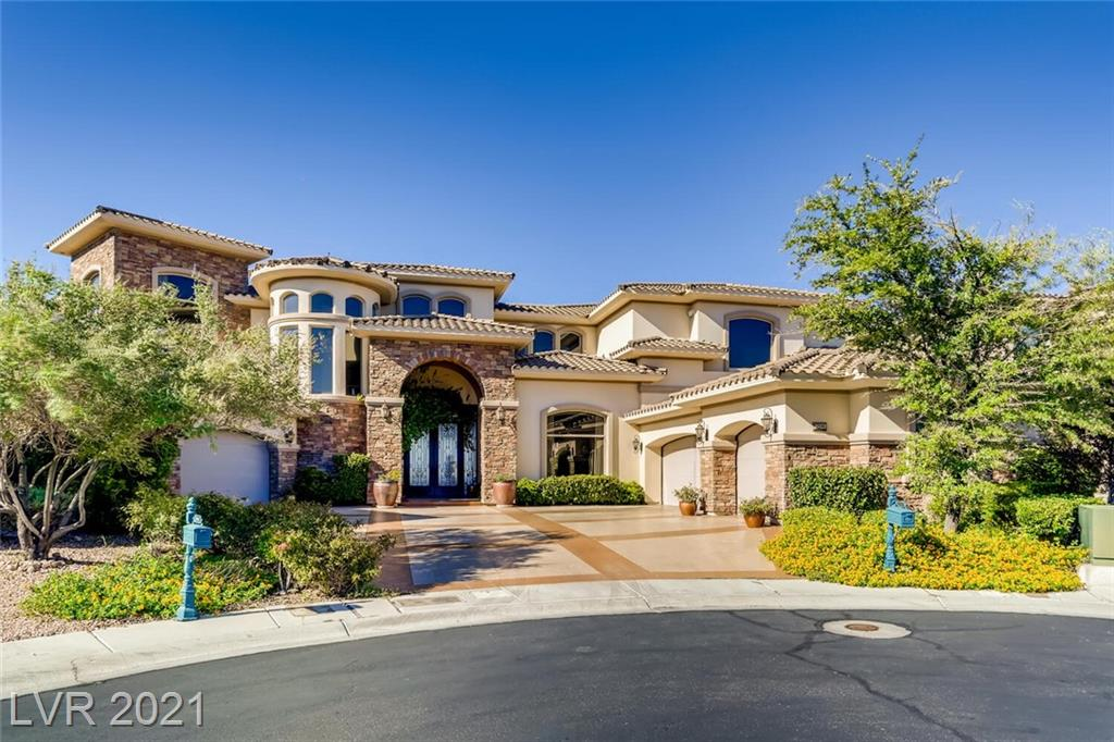 This custom home located behind the gates of Portofino in Seven Hills features stunning strip and city views from every room. From the primary bedroom, you will see breathtaking views of the backyard oasis. Open living room with pocketing doors to create indoor/outdoor space. Recently remolded kitchen including Wolf and Subzero appliances great for entertaining, as well as wine cellar, home office, full movie theatre, billard/game loft, residential elevator, and spacious driveway. Home also features, surround sound, security, central vac, strip/360 view roof top deck, pool & spa with waterfalls, outdoor kitchen w/ pizza oven. This home is a must see, with immense light throughout and a true sense of luxurious living.