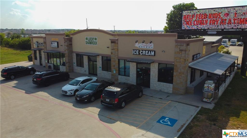 The S.K Plaza Is Located Just West Of Walmart Super Center On Stan Schlueter Loop.  This Commercial Center Comes Complete With 4 Individual Rental Spots [101, 102, 103, 104]; Plus An Electronic Bill Board Sign, An ATM Machine, An Ice Machine, A Food Truck Rental AND 43 Parking Spots.  Gross Income is Currently $9030 Monthly. The Lot Behind S.K. Plaza Is A Part Of The Sale And Offers An Additional 2.104 Acres and Has The Potential For A 2nd Phase Of 14,000 Square Feet Building! The Building Sits On .864 Acre Lot + The Lot 2.104 Acres For A Total of 2.968 Acres.