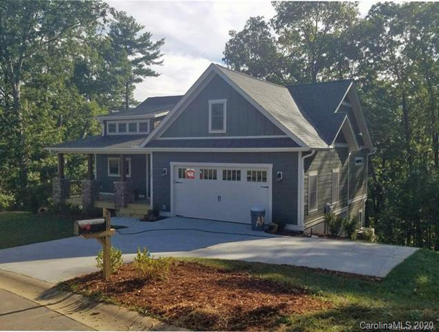 This arts and crafts plan has an open floorplan great for entertaining. The kitchen has a peninsula that allows for a breakfast bar while keeping the kitchen uncluttered. The house has main level living with the master suite on the main level and the laundry room. The daylight basement host 2 bedrooms a full bath and a large family room. Enjoy the covered back porch to sit and enjoy a cup of morning coffee. Wood floors throughout the main living area, tile in the baths and a beautifully tiled shower in the Master suite.  This home is pre-construction and located in a small quaint subdivision in Fairview with only 3 lots left to build on. It has a green space with a barn and raised garden beds. Cool Mountain Construction is the approved builder with many more plans to choose from or bring your own. 