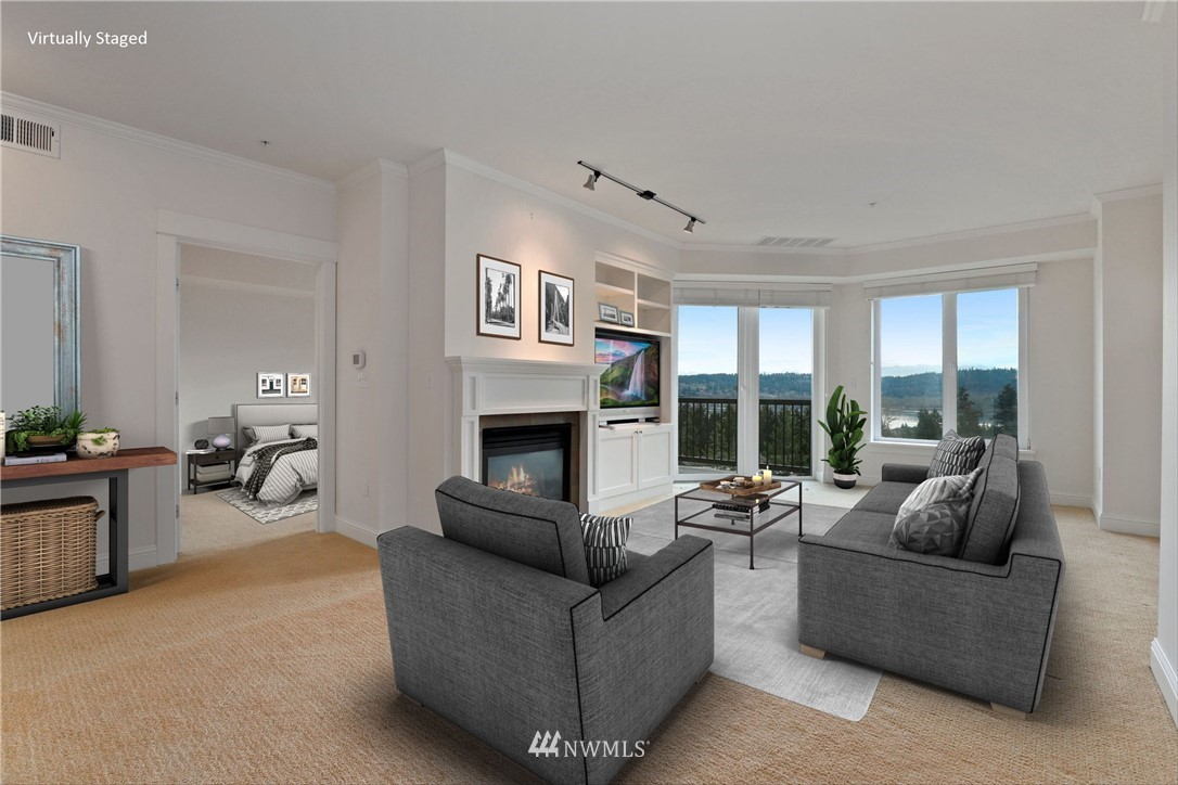 Stunning 3rd flr VIEW CONDO in the Monohan –a secure lodge-style building! The open floorplan offers a UNIQUE home filled w/NATURAL LIGHT a wall of windows! East-facing windows fill home w/VIEWS of blue Lake Sammamish, the jagged mountain range & green Lake Sammamish State Park! Chef's kitchen w/ slab granite counters, SS appliances & breakfast bar. Work from home in QUIET sitting room/office/den tucked neatly away. Marble counters in the bathroom, radiant heated floors in primary bath, HW floors, high-end lighting in living & kitchen, upgraded guest bath fixtures & cabinetry & central A/C complete the PERFECT PACKAGE! Two parking spots in common garage. Storage locker in secure room. Strong HOA, gym & community clubhouse. Welcome home.