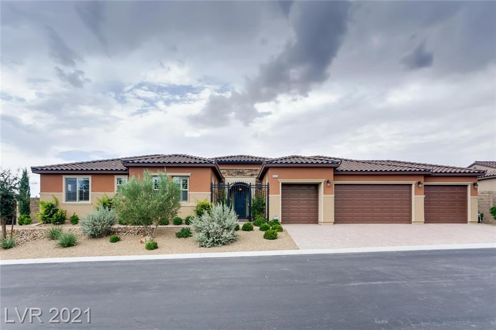 *BEAUTIFUL ONE STORY CUSTOM HOME*LARGE 4 CAR GARAGE*OPEN FLOOR PLAN*TONS OF NATURAL LIGHTING*SPACIOUS LIVING ROOM*CEILING FANS THROUGHOUT*30 INCH SUB ZERO FREEZER AND REFRIGERATOR IN KITCHEN WITH GRANITE COUNTER TOPS, STAINLESS STEEL APPLIANCES AND ISLANDS*LARGE MASTER BEDROOM WITH SEPARATE TUB IN MASTER BATHROOM*SEPARATE LAUNDRY ROOM WITH CABINET SPACE AND SINK*LARGE OPEN BACKYARD WITH SYNTHETIC GRASS*LOW MAINTENANCE DESERT LANDSCAPING*