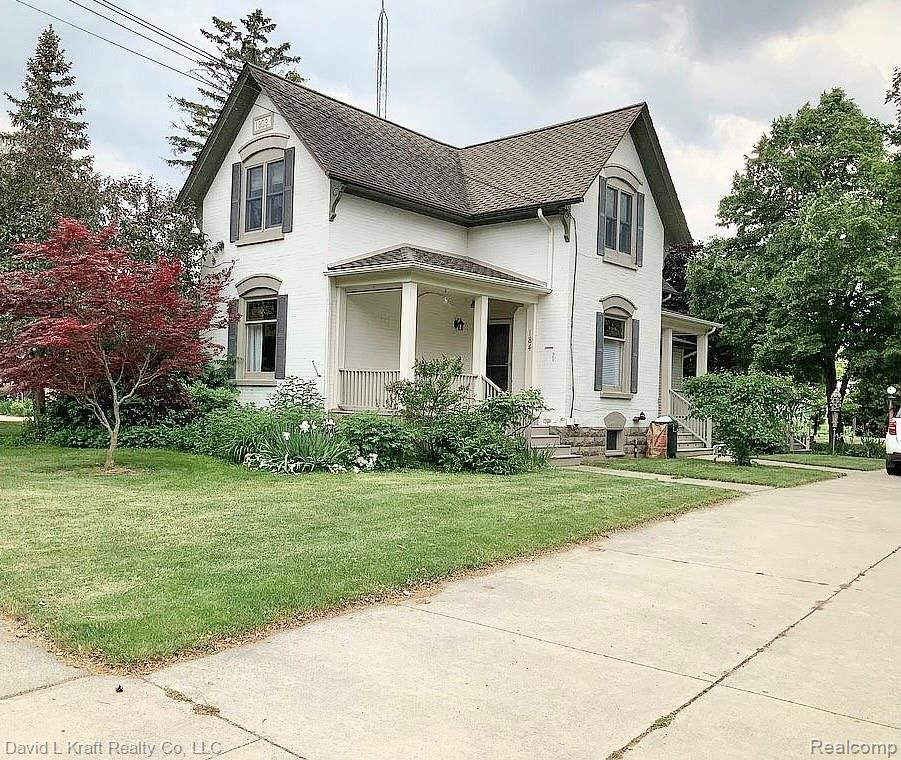 """IN TOWN CONVENIENCE: Here is a great 1909 turn of the century 2 story home with 4 bedrooms, 2 full baths, Large country kitchen with eating space. Resident bedroom with Natural Gas Fireplace makes a very cozy spot from the rest of the house.  Huge 7'-10"""" x 10'-10"""" walk in closet & resident bath 11'-11"""" x 15'-4"""" with Kohler River Tub, stand alone shower & 2 skylights.  3 bedrooms, 1 bath with jetted tub on second floor gives you plenty of space for family or guests. Windows updated 25 years ago. Stained glass windows imbedded within the thermo pane windows. 30' x 62' heated & insulated garage built 1981 with large workshop area at the rear. A true man cave. 50 year shingles on house now 19 years old."""