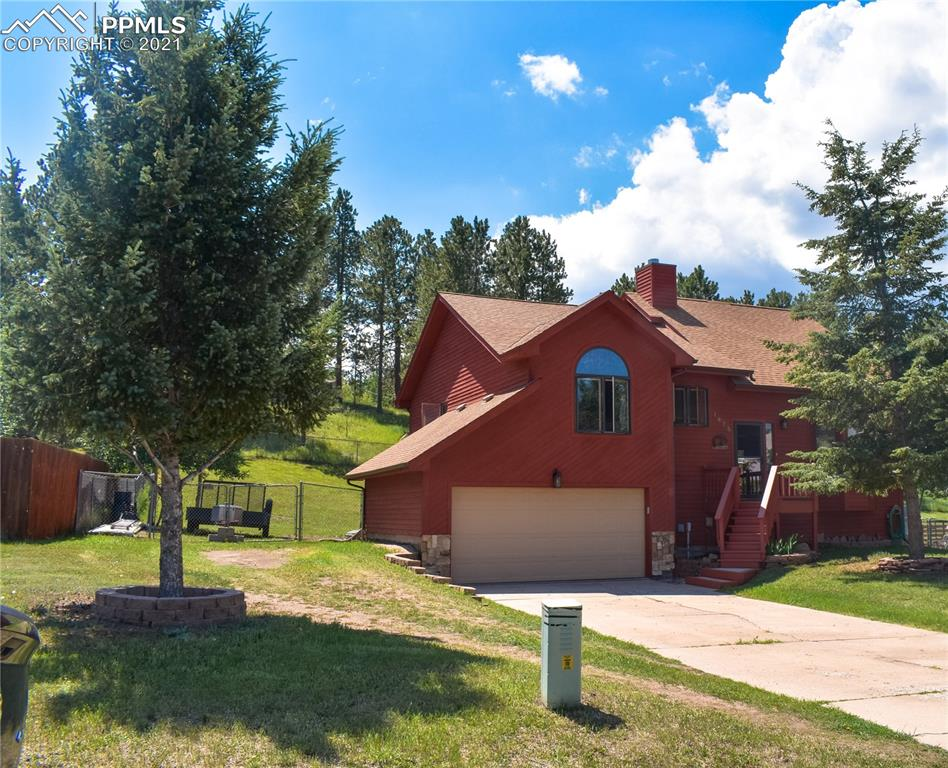 Don't miss this custom-made 3Bdr/2Ba home in the highly sought after Woodland Park area. This home is filled with natural wood throughout the home and an abundance of natural light pouring in through the many windows. Vaulted ceilings crate an open feel throughout the living and dining area. The kitchen features custom cabinets, granite countertops, and upgraded stainless steel appliances. Two bedrooms sit on the main floor and are separate from the master suite. The second bathroom includes the laundry area and is conveniently located in the home for easy access. An additional room downstairs could be used as an extra living room, office, or even an additional bedroom. The back of the home features a large red wood back deck and a spacious backyard for your kids or grandkids to enjoy! The oversized garage has additional storage space or extra space for a work area.