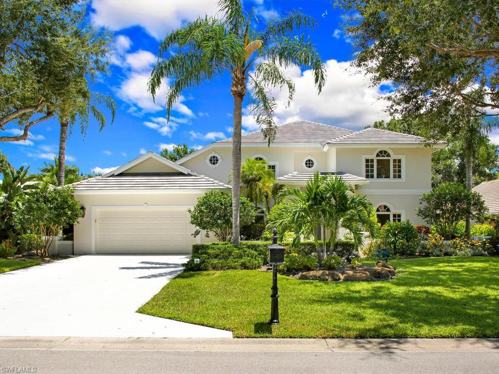 You'll be WOW'ed by this gorgeous 5 bedroom + den, 4 bath home in the prestigious neighborhood of Valley Oak at The Vineyards! Minutes from world-class shopping/dining, as well as SWFL's white sand beaches. The main floor is centered by a majestic winding staircase, reminiscent of days gone by, and beautiful dark hardwood floors that are carried throughout the main living area. The oversized sliders and abundance of windows in the freshly painted great room draw you outside to an impressive lanai, built for entertaining Florida style w/ a large saltwater pool, brand new filtration system, spa, wet bar and pool bath complete w/ shower. The expansive kitchen is equipped with stainless steel appliances, a breakfast bar, granite counters and loads of storage that include a kitchen island. The first-floor, newly carpeted master is light and bright w/ access to the lanai, and is accompanied by a breathtaking ensuite fit for royalty w/ separate vanities, marble waterfall countertops, a large walk-in shower and a stunning soaker tub. The second floor boasts 4 more generously sized bedrooms, and 2 more beautifully appointed bathrooms offering plenty of room for everyone.