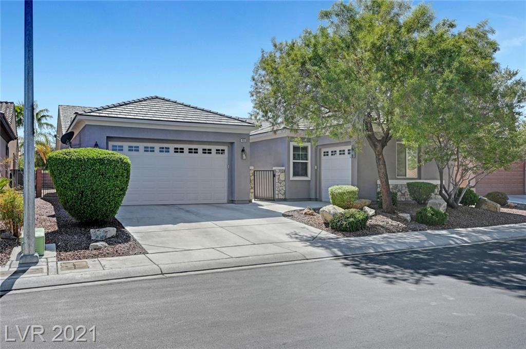Single story home with private courtyard, 4 bedrooms, 3 bath, 3 car garage. It has high ceilings, tile flooring throughout wet areas and laminate in all bedrooms. Formal dining area, living room with cozy fireplace. Fully upgraded kitchen with all stainless-steel appliances, granite counter tops, island and a huge breakfast bar. Large back yard with cover patio awaiting to be transformed/designed with your personal touch maybe with a swimming pool (see pictures) Aliante single story gated community, surrounded by walking/jogging paths next to Aviary park....