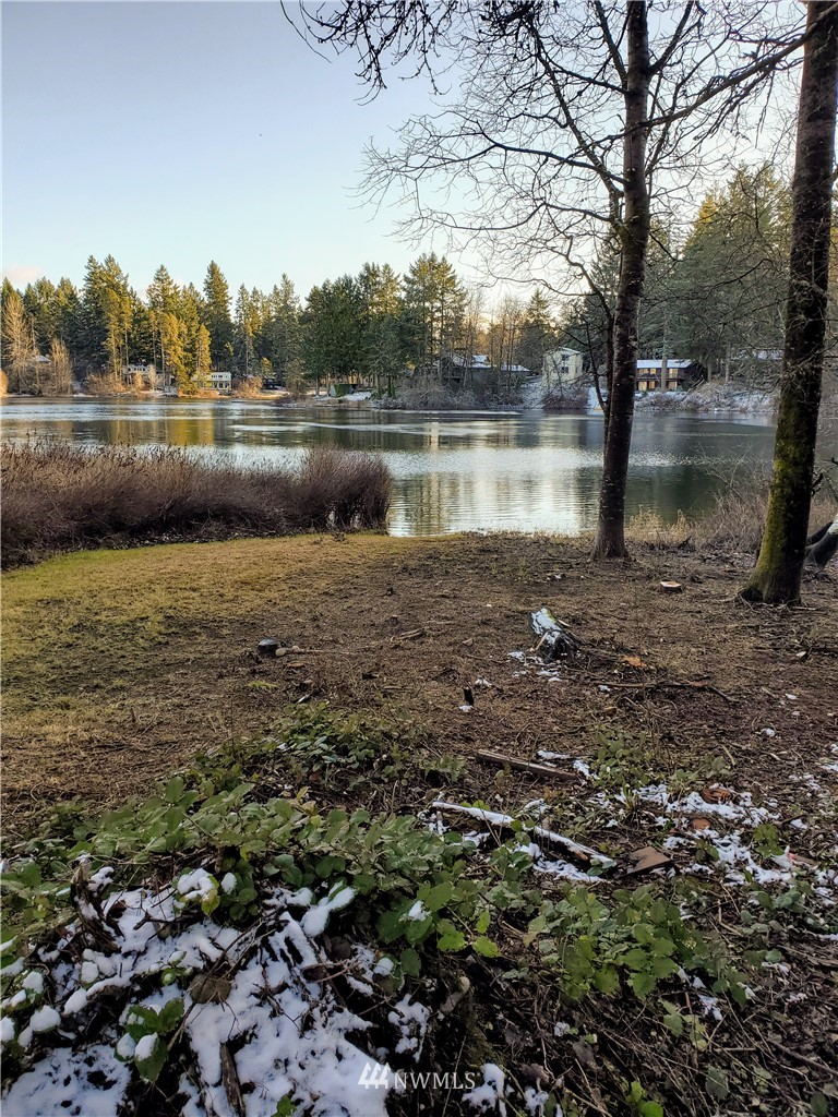 Beautiful setting gradually slopes down to your own 52 feet of frontage on Stansberry Lake inside the gates of Lake Holiday. Property is cleared and ideal for a daylight basement or rambler, close to the boat launch, walking or paddling distance to the community parks and sports courts. Well managed HOA, utilities in the street, previously started design for 3 bedroom septic and 1584 square foot home - requires very little site prep to start building your dream lakefront home !
