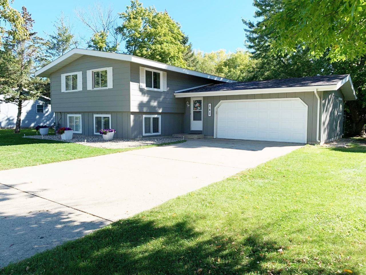 Welcome to Lakeview Drive, Within Walking Distance of Shopping, Parks, Trails, Lakes & More!! This Property is About .75 of an Acre Between the Two Parcels With A Great Wooded Area in the Back Full of Wildlife That Adjoins DNR Property. Inside The Home, The Upper Level Hosts The Kitchen, Dining, And Spacious Living Room, Along With 2 Bedrooms and A Bathroom. Great Vaulted Ceilings Throughout! You'll Find Another Bedroom, Bathroom, Laundry and Large Family Room in the Lower Level. Could This Be Your New Home? Don't Wait, Call Today!!
