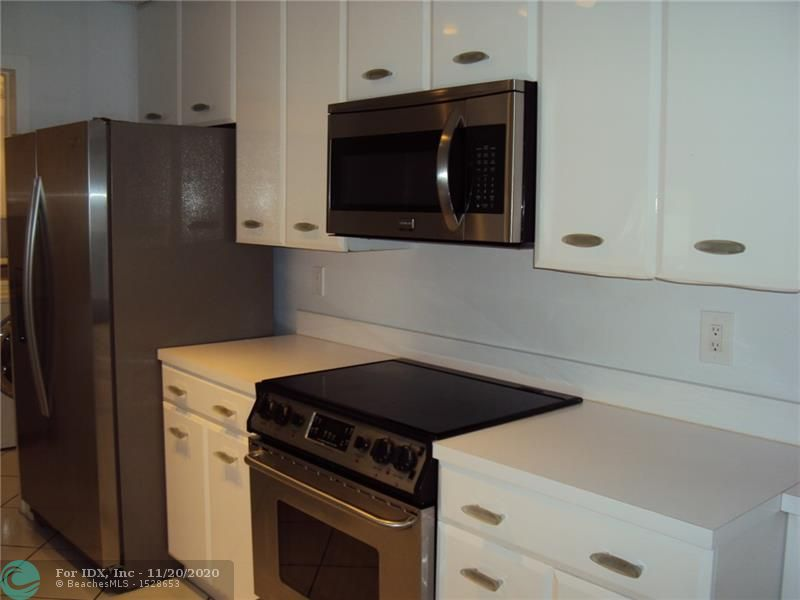 You'll love the size of this 2 bedroom townhouse in popular Deer Pointe community. This unit has newer appliances and an eat in kitchen with lots of counter and cabinet space. The large screened patio wraps around the back of the unit and has additional storage space. This is an all ages and pet friendly community in a great Deerfield Beach location. Very close to Quiet Waters Park, shopping, restaurants, golf and more. Low fees only $134 per month.