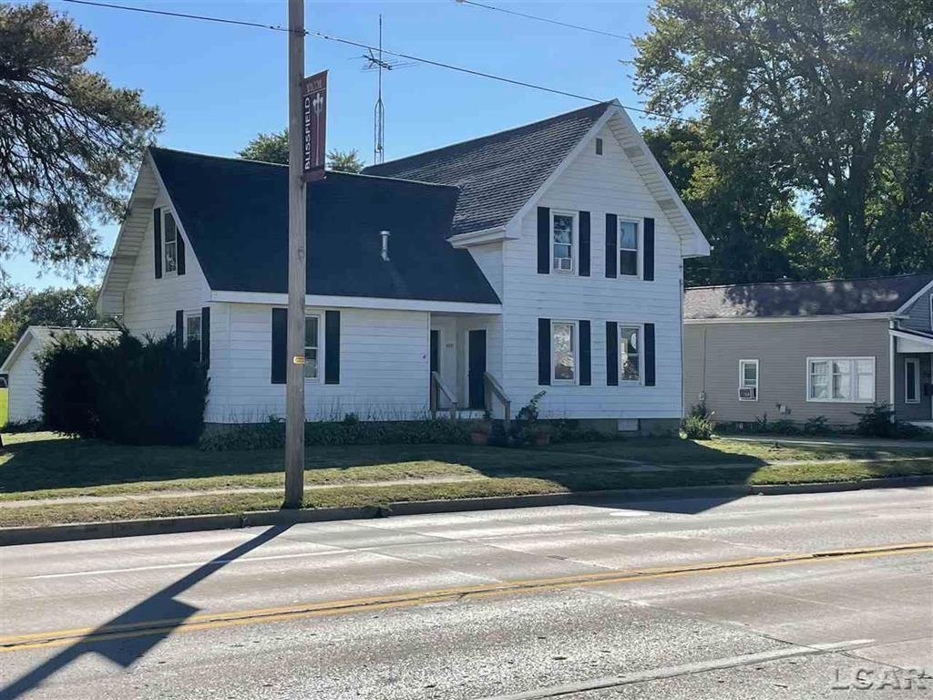 Great 4 bedroom 2 bathroom home in the village of Blissfield. Main floor bedroom and laundry. Upper floor has 3 bedrooms, full bath and large unfinished attic space. Home has hardwood floors throughout. Newer furnace, windows, roof, water heater. Nice sized lot with detached 2 car garage.