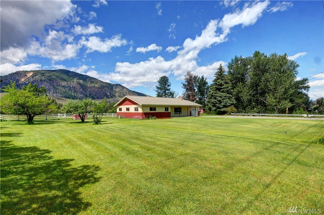 Mid-century modern farm! This classic home has everything you need to be self-sustainable w/ plenty of extra rooms for everyone. Enjoy outbuildings, fully fenced pasture & the sound of Beaver Creek on this unique 7-acre property. All the outbuildings  are in place for horses, chickens, & other large & small animals. Enjoy this peaceful setting with mountain views,  creekfront, & beautiful pastures.  Enjoy this move-in-ready home. Country living at it's best!