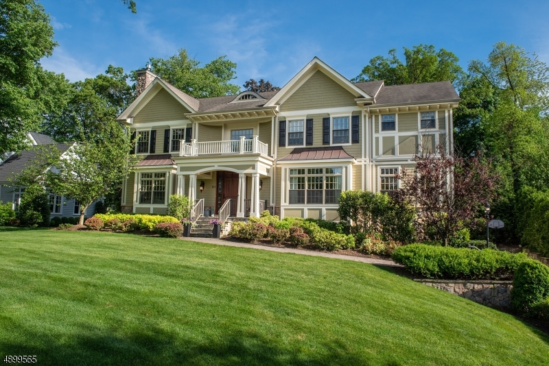 Stunning  2010 6BR 5.2 Bath Colonial in coveted location close to Franklin School and New Providence train station. Featuring a gracious Entry Foyer, Custom Kitchen w/ White Cabinets, Huge Center Island, Top of the Line Appliances, wet bar & sunny Breakfast Room open to the Family Room w/ Gas FP & French doors to patio & professionally landscaped level yard .Formal Living Room w/Gas FP & Formal DR are perfect for entertaining Sonos Sound System and a Private Bedroom w/ Full Bath. Second level boasts a lovely Master Suite w/ Sitting Room, elegant bath & 2 walk-in closets, 4 additional BR's & 3 Full Baths and a convenient Laundry Room. The finished Lower Level includes a spacious Rec. Room, Powder Room, Mudroom and 2 entrances to the 3 car garage. Custom Millwork & Moldings.