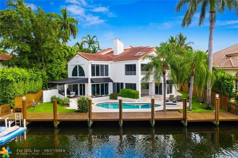 Contemporary Sophistication abounds in this Seven Isles stunner! This 5br/4.5 bath +/- 4,000 sf home with 80ft of Waterfront is perfectly sited on the highly sought-after street of Aqua Vista.  Entertainers beware, you will have a hard time getting your guests to leave with a plethora of inviting spaces both inside and out! Tastefully updated kitchen with Stainless steel appliances, Island and butlers pantry. Multiple Wine Fridges, separate wet bar area and double sided fireplace. Huge Master Suite with Steam Shower and large Jacuzzi Tub. Welcoming covered porches offer special moments all leading to a large heated pool/spa. Whole House generator, hurricane protection, 24 hour security and a short stroll to the beach, shops and downtown.