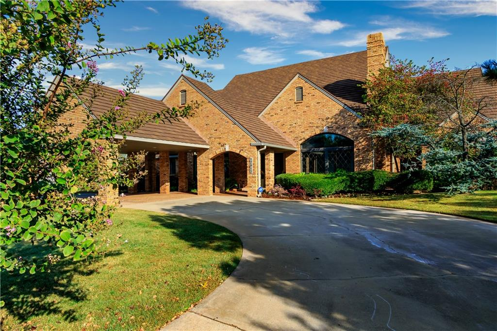 IMPRESSIVE YET UNDERSTATEDLY AND CASUALLY ELEGANT, TIMELESS, ABSOLUTELY STUNNING THEN AND MORE SO TODAY all describe this Bill Quigley beauty.  Built as the neighborhood's Show Home/Parade of Homes it boasts a design way ahead of it's time and is one of the best kept secrets of FINE homes in OKC.  It wreaks of QUALITY.   Upon entering  you are greeted by large open spaces, wide halls, high ceilings. and massive quality windows creating a feeling of expansion and light. Four bedrooms and 5 baths are on the first level,  separate His and Hers baths in the master.  The upstairs is a self contained space with full bath and kitchenette perfect for Nanny, guests, home business, etc.  Room for everyone and everything.  Come enjoy warm and friendly living.  We love to show it. You will know you have found the one!