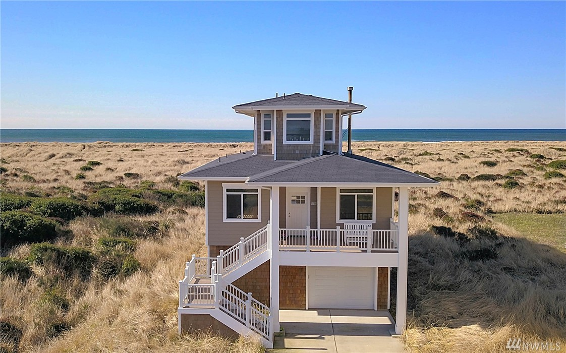 Beautiful oceanfront home just built on the beach in Ocean Shores, Washington. This 2406 square foot home has a large garage with an attached storage room for your surf boards, kites, and fishing gear. Incredible ocean views from almost every window and large living areas with custom upgrades, fireplace, and ceiling fans. Home comes fully furnished and totally turn key. There is a bonus room downstairs that could easily be utilized as a 4 bedroom. Walk right out the back door onto a sandy beach.