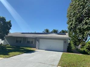 BEAUTIFUL UPDATED HOME - PRIVATE BACK YARD WITH  POOL AND A CANAL VIEW- 2 CAR GARAGE- LARGE EAT IN KITCHEN- ACCORDIAN SHUTTERS THOUGHOUT- QUIET NEIGHBORHOOD  AND NO HOA TO DEAL WITH - FRUIT TREES - DONT MISS IT !!!!