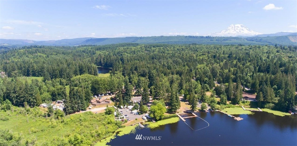 Camp Lakeview and surrounding properties. One of a kind lakeside development property 24 tax parcels on 300 acres. 1,500 feet of frontage on Lake Tanwax includes boat launch and two docks. A 25 acre private lake, water skiing and recreational boating allowed. Existing RV park for 22 with 28 additional sites and 18 partial hookup sites. 6200 SF lodge that can accommodate 52 people, several meeting halls, 12 cabins, and several homes. Includes conditional use permit for approximately 140 RV sites. 50+ cottages and 25+ buildings. Potential uses include estate homes, private retreats, horse ranch, private RV park and resort, conference center, or year round training center. A significant must see estate.