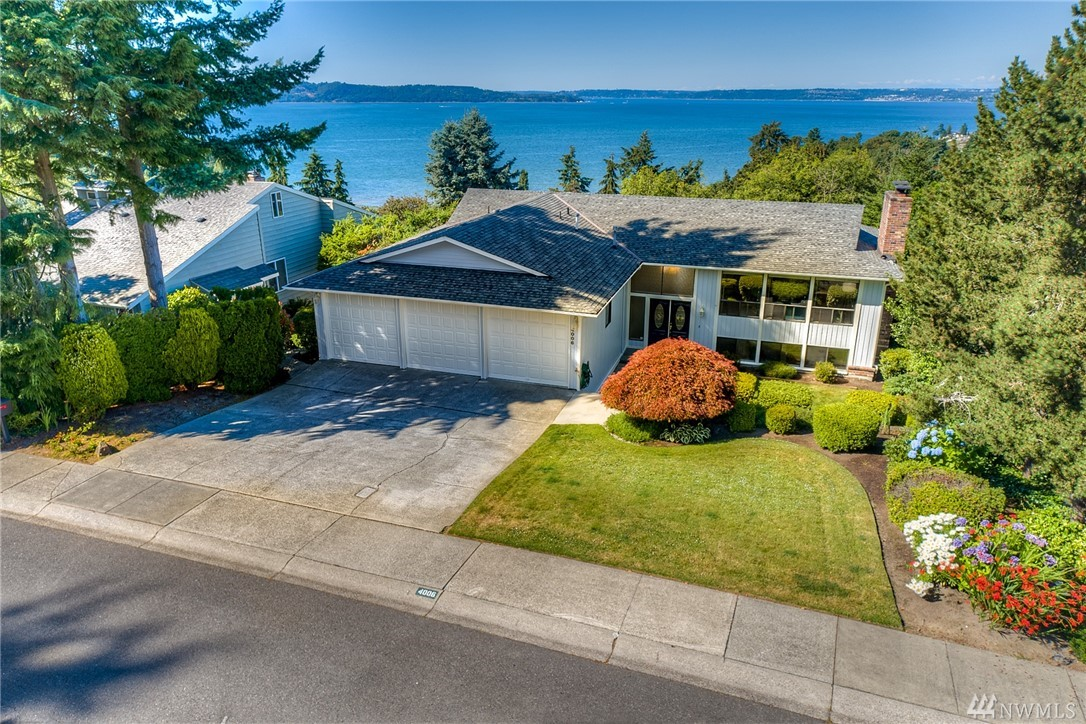 Remarkable views of The Sound, Maury Island & The Olympic Mountains! Spanning 3,600 Sq Ft this home features views from every angle! Chefs kitchen W/tile back-splash, gas range & dbl oven! Open dining W/views of the sound & living room W/wood burning FP. Master ste W/slider to deck, WI closet & 5-piece bath. Lower level bonus rm, family rm & wet bar. Entertainment size deck overlooking the fairway of Twin Lakes Golf Course. 3 car garage W/room for golf cart! 2.5 miles to Dash Point State Park!