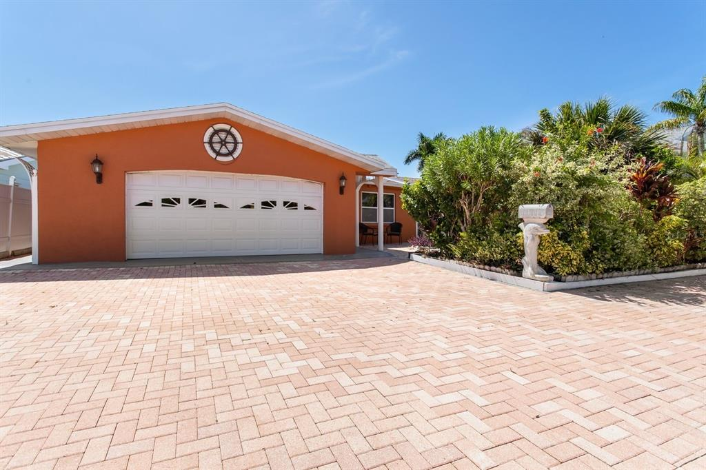 """This home is located in a great family friendly neighborhood within walking distance to the beach with access to great restaurants, entertainment, and shopping areas. It is a lovely deep water home with dock and boat lift and 50 ft of water frontage. It has four bedrooms, three full baths, a two car garage and is located on a salt water canal extending from the Boca Ciega Intracoastal. The patio and flower gardens surrounding the home provide a beautiful place for entertaining family and friends. The home is made of cement block, is protected by hurricane resistant windows and a hurricane resistant garage door. It has electric hurricane shutters and an ADT security system. The """"Trane"""" central air conditioner/heating system is new, and the hot water tank and refrigerator are new. The house has a water filtration system, and french drain. This home has great potential! You'll have to see it to appreciate it."""