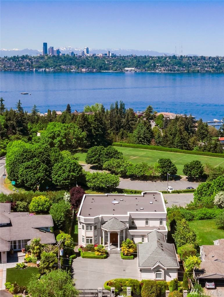 Boasting idyllic west-facing lake & city views, this like-new custom home was constructed w/unparalleled craftsmanship & the Seattle  skyline in mind. The chef's kitchen, custom built-ins, expansive deck & great room are ideal for entertaining. Featuring 5 ensuite  bedrooms, media & exercise rooms, gated entry, private downstairs apartment, prime access to I90 & so much more. This home is the perfect balance of function, opulence & comfort—all at once. Welcome home, your nightly sunset awaits.