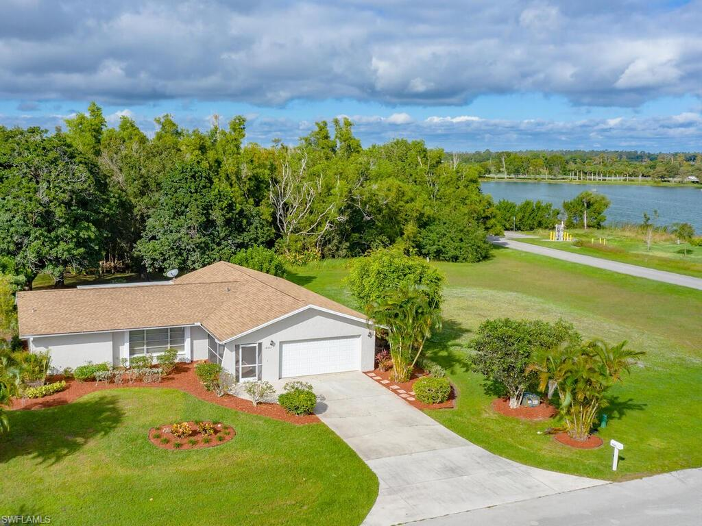 It's here - YOUR opportunity to live in ROYAL PALM GOLF ESTATES for UNDER $300,000!  OPTIONAL GOLF MEMBERSHIP & low, low HOA fees!  See this NEWLY UPDATED 3BR/2BA PLUS Den RANCH home on almost 1/2 acre in a LUSHLY LANDSCAPED, nature-lovers setting. The SPLIT FLOOR PLAN with the primary suite on one side & 2 guest bedrooms on the other, offers privacy & quiet enjoyment!  Inside you'll delight in all the FRESHLY-PAINTED rooms, remodeled bathrooms with NEW VANITIES, COUNTERTOPS, FAUCETS, COMMODES & MIRRORS,  DOORKNOBS/HARDWARE & LOCKS throughout, 5 new ceiling FANS, & more!  OUTSIDE you'll love the pristine NEW PAINT, new EXTERIOR LIGHTING in driveway, on porch & lanai, new patio SCREEN ENCLOSURES & DOORS, even a NEW ROOF IN 2018!  Entertaining is a breeze as you treat guests to dining al fresco on the COVERED LANAI, toasting s'mores over the concrete FIRE PIT, or retreating to the comfort of your dining room with huge backyard views.  ROYAL PALM'S OPTIONAL MEMBERSHIP offers the GORDON LEWIS COURSE with a CLUBHOUSE,  SPORTS BAR, and RESTAURANT. Just 5 miles East of US 41 and Collier Blvd (951).  Minutes to MARCO, NAPLES, shopping, dining, & boating.  See the pix & virtual tour now!