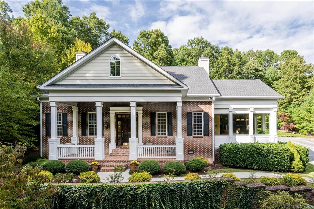 Exceptional 2 story brick Greek Revival home w/ Southern Charm boasting stately appointments, designer-like style and architectural magnificence. Situated on 1.5 acres w/ manicured grounds surrounded by stream, walkways, paths and gardens affording the utmost in privacy. Main level living featuring HWD floors, vaulted ceilings, crown molding, living rm w/gas fireplace, built-in bookcases, large picture windows, kitchen w/ high-end appliances, arched brick surround Dacor gas cooktop, granite, island w/ prep sink, window surround breakfast area, dining room, master suite w/ gas fireplace, built-in TV cabinet, dual granite vanities, walk-in tiled shower, jet tub, his/her walk-in closets, den w/ gas fireplace, built-in bookcases, wet bar, powder bath and laundry room. The upper level features 2nd master suite, 2 guest rms w/ Jack & Jill bath, den w/ powder bath, study/gameroom with access stairs to main. Outdoor living options include the covered front porch, covered patio and paver patio.