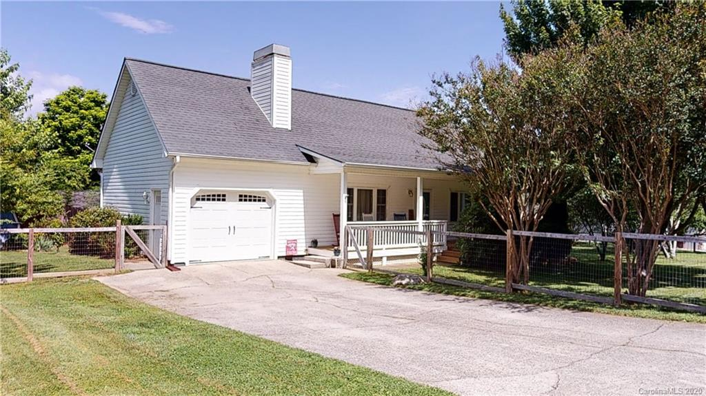 Charming 3BR,2BA home located 10 minutes from Downtown Hendersonville! Beautifully landscaped with flowers and fruit trees, across from Burntshirt Winery. Simple and easy access to I-26, and perfectly situated on a low-traffic cul-de-sac road. New HVAC installed in 2019! Featuring a stacked stone fireplace, granite countertops, wood floors throughout main level, stainless steel appliances. Main bedroom with ensuite bath and walk-in closet. French doors lead to a picturesque sunroom. Fenced yard, front covered porch and large back deck are great for entertaining. Garage and shed with ample storage. 3D virtual tour available!