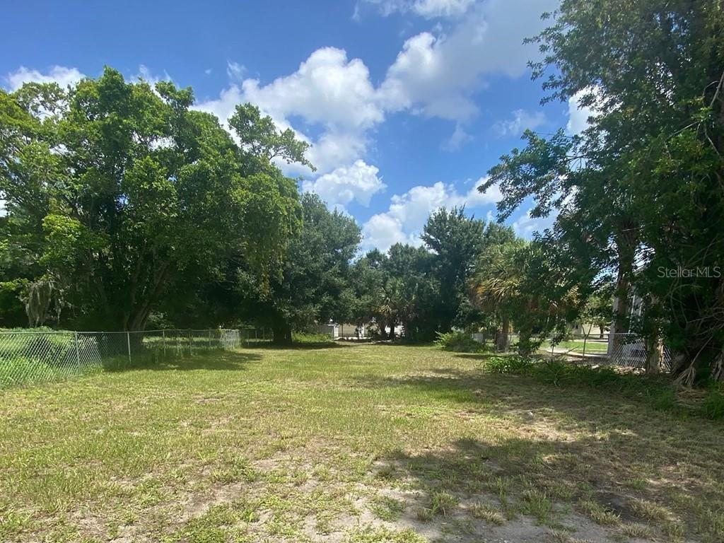 CLEARED VACANT RESIDENTIAL LAND!  This well-located lot is fenced on three sides and is at the edge of the flourishing Village of the Arts district: an eclectic mix of live/work/play homes.  It is also about a mile to Downtown Bradenton on the Manatee River.  As a bonus, you are just across the road (500-feet) from the Rogers Garden Bullock Elementary School and Lecom Park (a ballpark used as the spring training home of the Pittsburgh Pirates).  It is within the city limits, sidewalks easily access destinations of interest, studios, shopping, dining, galleries & more!  Other popular places nearby would be Old Main Street, Riverwalk, Bishop Museum, Wares Creek, parks, and playgrounds.  Plus, you are less than 10-miles to the beaches of the famed Anna Maria Island.  There are no HOA or deed restrictions to contend with, so build your perfect home with room to park your boat or RV!  **WOW!  Zoned Residential AND Limited Retail, please see attachment for possibilities  WOW!**