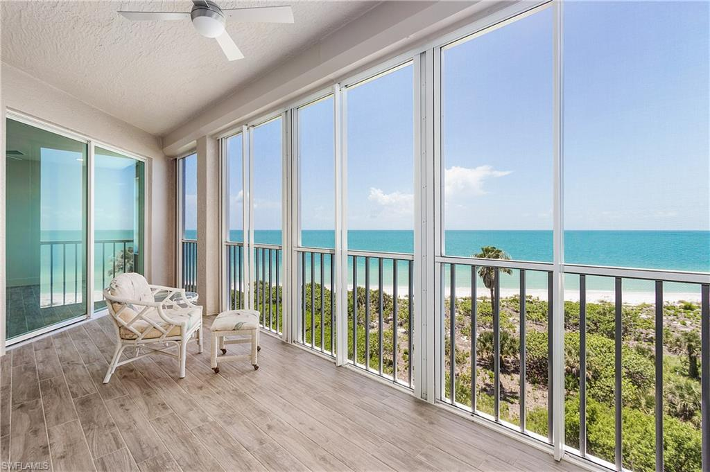 Rarely available condo in beautiful Barefoot Beach Club. This pristine 5th floor unit features 2 bedrooms and 2 full baths. Enjoy endless sunsets and sunrises, Gulf views from living room and owners suite. This unit has been tastefully renovated. The ceiling has been raised to support an open air feeling with sleek contemporary design and fine quality finishes throughout, from Lacava fixtures and Fisher and Paykel refrigerator to unique features all around this unbelievable piece of paradise. You will not want to miss out on the famous Florida lifestyle that includes friendly neighbors, private beach access and community events. The optional one of a kind beach club membership including a fitness center overlooking the beach, full beach and pool service, house guest privileges and more.
