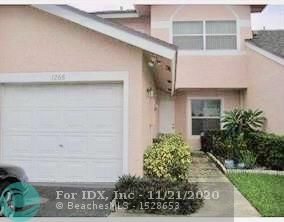 Beautiful townhome with a garage conveniently located near all major highways and minutes from the beach. This lovely 2 bedroom / 2.5 bathroom home is spacious with both bedrooms upstairs and a plus with the privacy of 2 full bathrooms located in each bedroom. Low maintenance fees! Great investment for rentals as well. Tenant occupied. Desired location right off Wiles and Powerline Rd. near many shoppes and restaurants. Large patio overlooking peaceful greenery and is perfect for a quiet evening or entertaining. Spacious vaulted ceilings upstairs. This one is priced to sell and won't last!!!