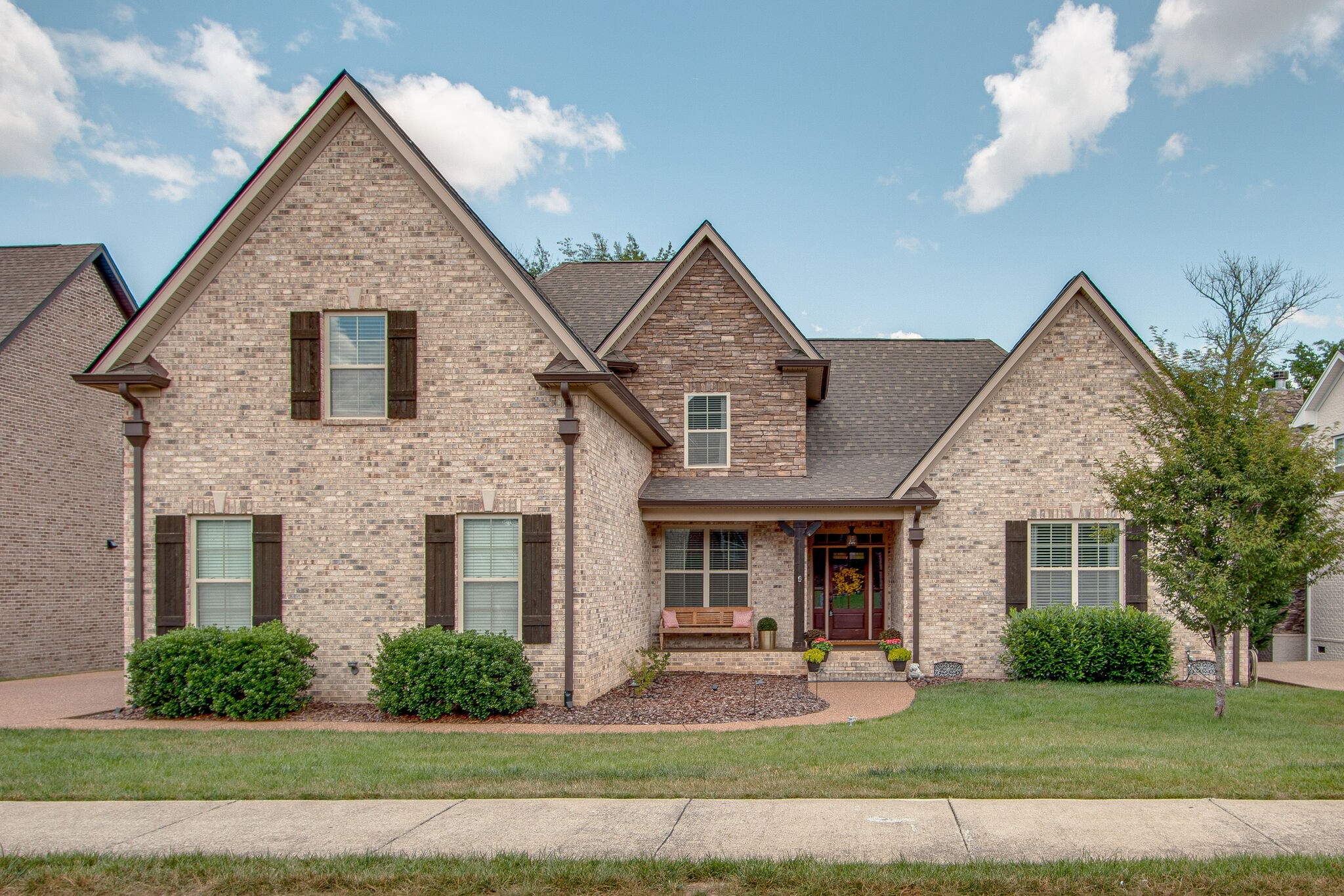 Fabulous! 5 Big BR (2 Down), all walk in closets, 2.5 Baths Down & 2 Up (All Tiled), Bonus w/bar, Vaulted Great Room, Hearth Room off of Great Big Kitchen w/ 6 seat Stone Wrapped Island, Breakfast Nook, Built-in Appliances, New Air Down, New Roof, New custom lighting, Huge Master Suite w/Stunning Master Bath w/ Wrap Around Shower,. Beautiful Private Treed Yard, Covered Patio, Trex Double Deck, Patio, Fenced