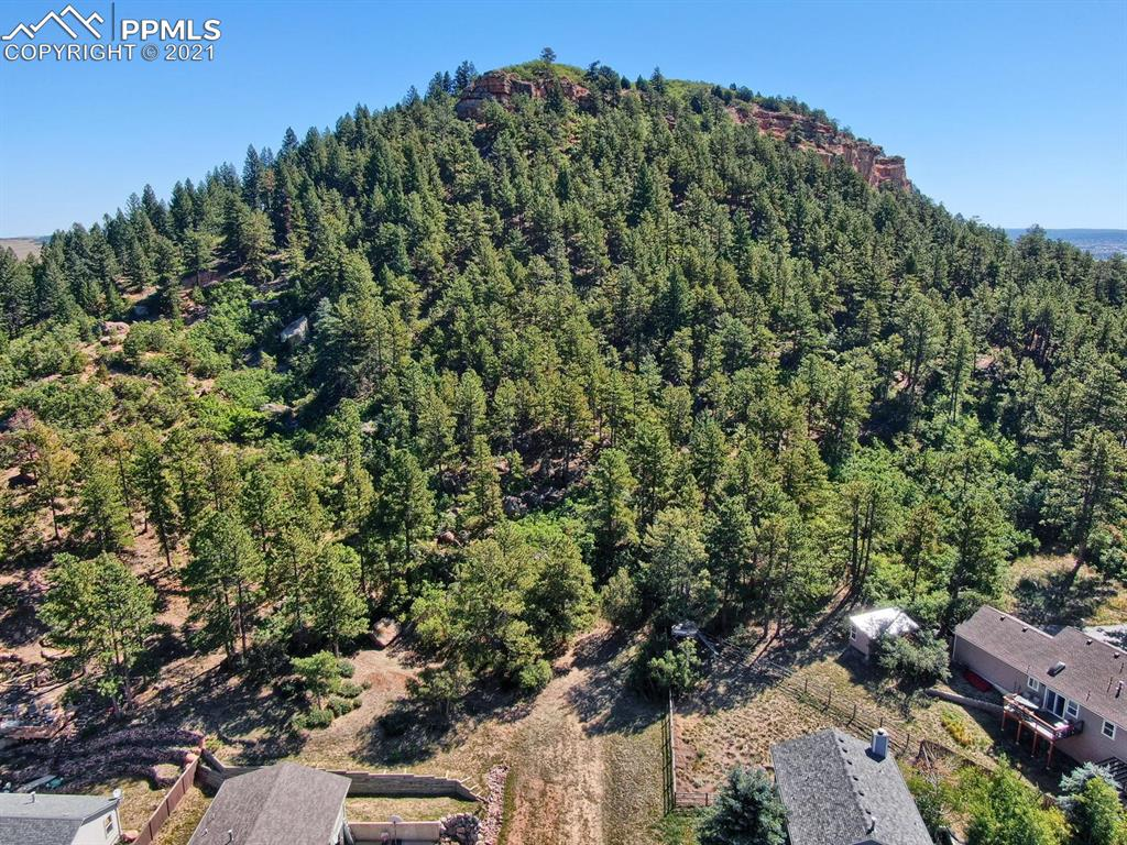 Build your dream home on this slice of paradise with stunning mountain & lake views! Treed, almost 1/2 acre, private lot with rock formations at the base of Ben Lomand mountain.   Walk to lake for fishing & kayaking, or to the Santa Fe or Greenland trail for hiking/biking.  Walk to playground/park & explore the quaint Town of Palmer Lake by crossing the new pedestrian bridge for restaurants, ice cream and elementary school. All utilities are near by. Oakdale Terrace is not built and there is no street sign. From the corner of Oakdale Ave & Grant Ave, go east on Grant Ave via undeveloped road. Lot is straight ahead. See virtual tour link for plat overlay.