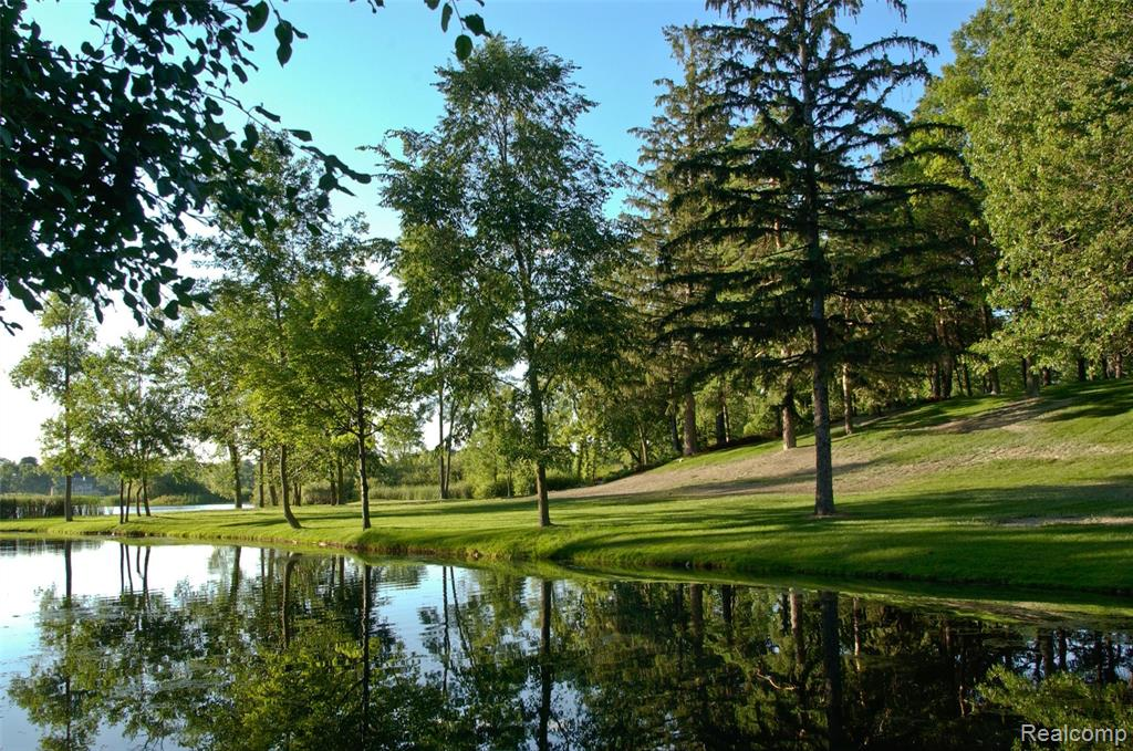 Nestled within the gated community of Turtle Lake sits a 5.74 acre vacant lot that was once part of the historic Stables Estate.  This spectacular building site is one of the largest vacant lakefront lots in Bloomfield Hills.  With over 465 feet of lake frontage and a building envelope that stretches near the water's edge, this property could potentially accommodate multiple structures including a boathouse.  Views of the lake and adjacent horse stable, dairy barn, and horse pastures are unlike anything in southeastern Michigan.  We invite you to visit this estate property to fully experience and appreciate it's rich splendor.  Potential for lot splits.