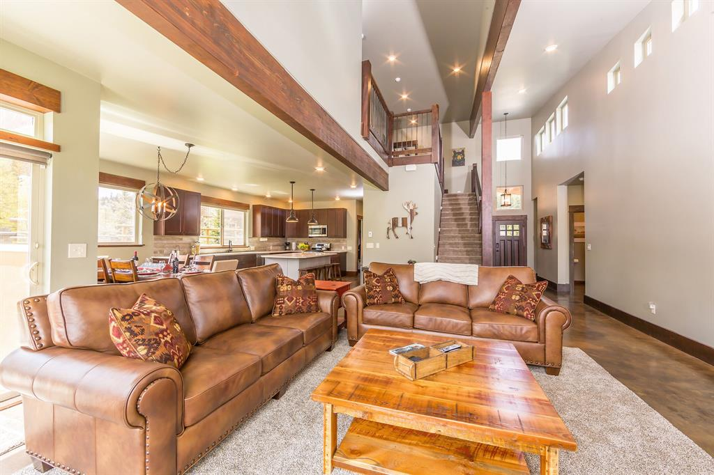 This beautiful 2815 square foot home is located in the heart of Big Sky.   With three bedrooms, two and a half baths and a large bonus room above the garage this Big Sky home is one you have to see. Cozy up to the gas fireplace on those cool summer evenings,  soak in the hot tub and watch the stars, or enjoy the views from the patio after a day on the trails.   Vaulted ceilings, open floor plan, radiant in floor heat on the main level, and custom finishes are sure to impress.  Plenty of room for all your toys in the large heated two car garage.  Fully furnished negotiable.