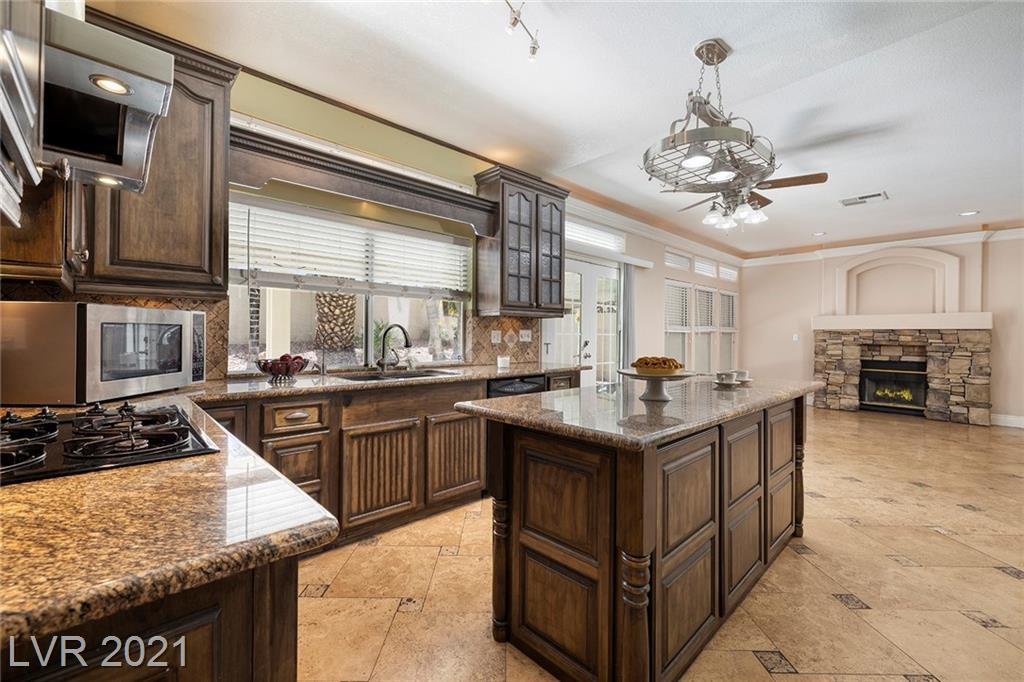 Beautiful Home in Dynamite Green Valley Location! 2,793SF, 5 Bed, 3 Bath, 3 Car Garage, Sparkling Pool & Spa, Low HOA, Travertine Floors w/ Inlays, Custom Cabinetry, Wine Chiller, New Dishwasher, R/O System, Covered Patio, Custom Lighting and Ceiling Features, Stone Fireplace, Master Retreat with Spa Bath, Walk-in Shower, Vanity and Oversized Closet with Professional Built-ins. Separate Living, Family, Dining Room and Office, Privacy Shutters & Blinds, Covered Patio, Mature Landscape with Numerous Palm Trees, Located just Minutes Away from Restaurants, Shopping, Bike Trails, Walking Trails, Parks, and More! 20 Mins to the World-Famous Las Vegas Strip, 15 Min to McCarran International Airport, No State Individual or Corporate Income Tax.