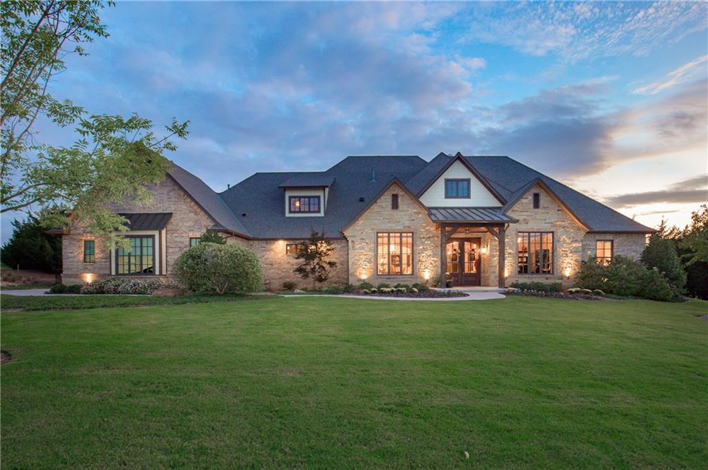 This custom home with craftsman & traditional design elements is not only beautiful & elegant but comfortable & livable…Home sits on TWO+ ACRES…Wooded back yard for privacy & room to add a pool…This gated neighborhood offers a superior location only minutes from Lake Arcadia, I-35 access & Edmond…Custom herringbone tile entry, hardwood floors, living area has cathedral ceiling with a floor to ceiling rock fireplace & exposed beams and  built-in cabinetry…Barn  doors, wine room & pantry…Kitchen is perfect for entertaining with a massive dine-in island, eating area and Bosch appliances…Master on the main level has his & hers vanities and designer closet has direct access to the laundry room…Two other bedrooms on the main level share a Jack & Jill bath…Study on 1st level…Bedroom #4 is on the 2nd level with a full bath and a living/tv room… Covered outdoor space with fireplace…There are so many custom features that a detailed features sheet is available -- ask your agent for features sheet