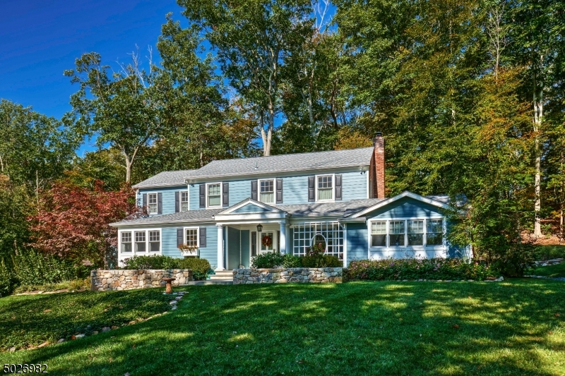 Custom Colonial situated on 3 AC w/ stone bridge & walls on a cul-de-sac road. Stream-side fire pit, Remodeled kitchen & baths. Master BR features cathedral ceiling & windows framing tranquil views. The 1st floor comprises the fireside back-to-back living room, dining room, office/den with cathedral ceiling, family room, guest bedroom, full bath, center-island designer kitchen and laundry room.  On the 2nd floor are the Master Bedroom with luxurious en suite bathroom and two custom walk-in closets, two additional bedrooms and the remodeled hall way bathroom.  The basement level has a recreation room, utility room & storage area. Amenities include hardwood floors, a front porch, numerous windows and neutral decor. There is a detached 1-car garage and 20 KW generator. Master bath steam shower mechanism as is.