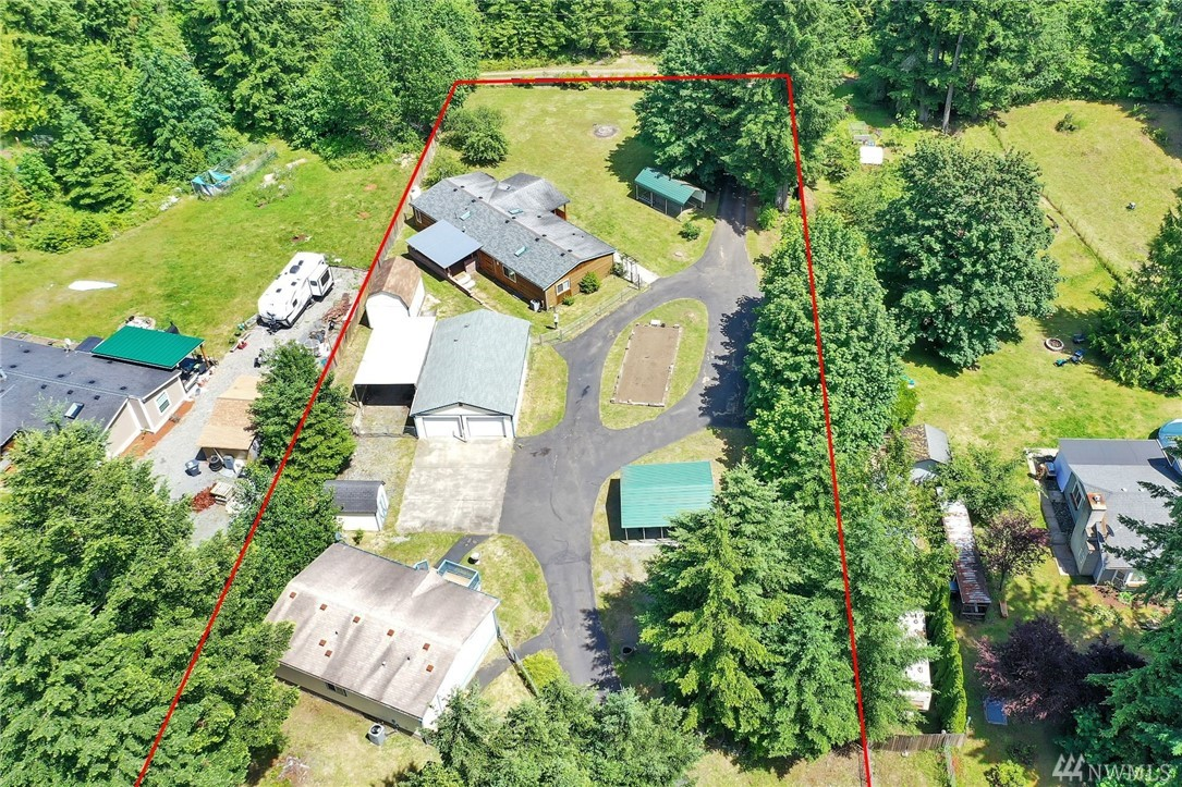 "Two upgraded manufactured homes on private 1.5 acres. Main is 4-bed, 2-bath w/ new roof, skylights, windows, flooring, cabinets & siding, plus generator-wired w/ propane fireplaces & range, tankless H2O & jetted tub/sauna. Additional is 3-bed, 2 bath w/ updated kitchen & 36"" doors for accessibility. Both homes have own heat pump & appliances stay. Fully-fenced & level lot has 2 gated entrances, jumbo 2-car garage/shop, 3 outbuildings, garden space, fruit trees & covered parking for RV & more!"