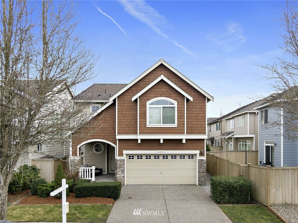Your new home in Saddle Creek is ready and waiting for you to move in!  Quaint covered front porch welcomes you into this  3 bedroom, 2.5 bath home featuring hardwood floors & open concept living on the main floor with a cozy gas fireplace and convenient powder room.   Upstairs is a large master with coffered ceilings and a 5 pc en-suite with a large soaking tub perfect for relaxing at the end a long day.   Two more bedrooms, a bonus room and laundry room complete this level of home.   Don't miss the cabinets and above head storage in garage!  Fenced back yard w/ trellis with fruit bearing vines and paver courtyard. Great location close to freeways makes commuting a breeze, or plenty of space for a home office or home school.