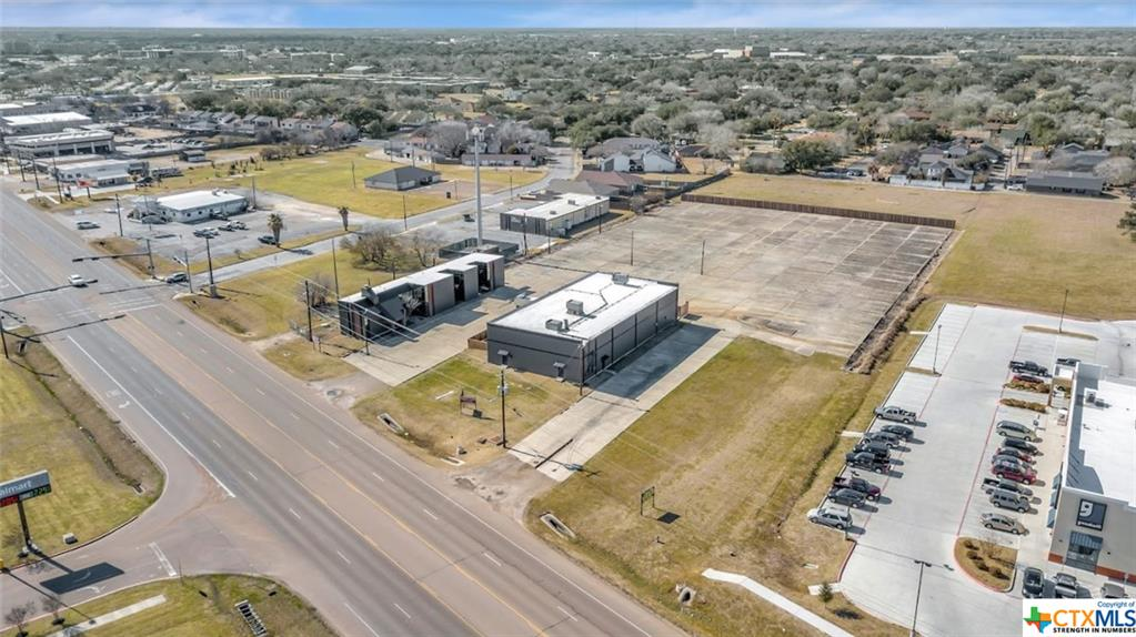 Great Commercial Location! 4104 Houston Highway offers over 3 acres of prime property with 2 commercial buildings and a high traffic count of 15k+ per day. This property features a 12,652 sf building that offers endless possibilities and a 5,737 sf office/retail space. Plenty of parking available. Located directly across the street from Wal-Mark and less that 1.5 miles from Loop 463, this location offers great exposure for any business. Both buildings are currently fully leased. Amazing property!