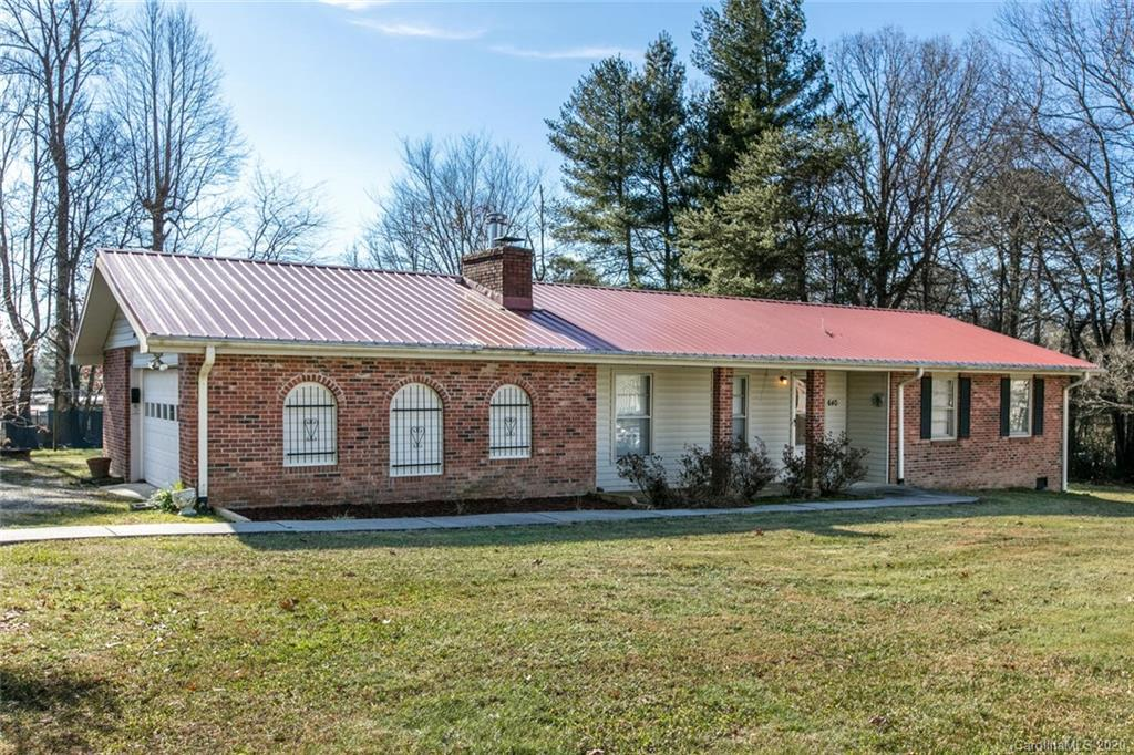 Don't miss this clean, well maintained brick rancher on an almost half acre lot!  This 3BR/2BA home has a new metal roof, new water heater/stove/dishwasher, new HVAC system in 2016, new laminate floors in kitchen and dining areas.  Spacious living room with brick hearth and wood stove, large dining room, plus bonus area could be den or office.  Huge front yard and backyard with storage building and room to play!  Great location close to shopping, I-26, and Four Seasons and downtown. Large utility room in garage with washer/dryer and extra storage space.