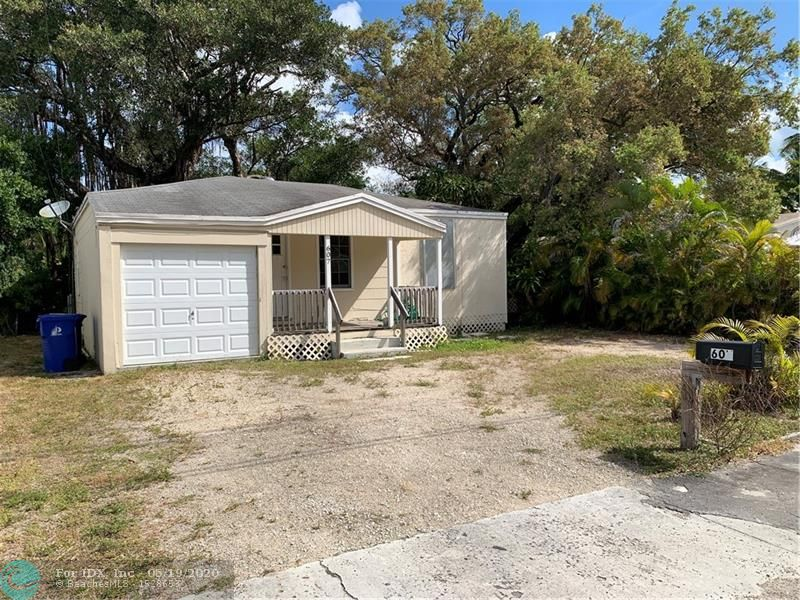 Handyman Special! Being sold below land value. Located on a dead-end street in the highly desired neighborhood of Tarpon River close to Downtown, Beaches, and Highways. This home is currently set up as a 2 bedroom 1 bath with garage but can very easily be converted into a 3/2. Home is zoned RD-15 with enough land to build secondary structure in back to turn it into a multifamily property. Perfect for investor to either fix and flip, rent, or build NEW CONSTRUCTION.