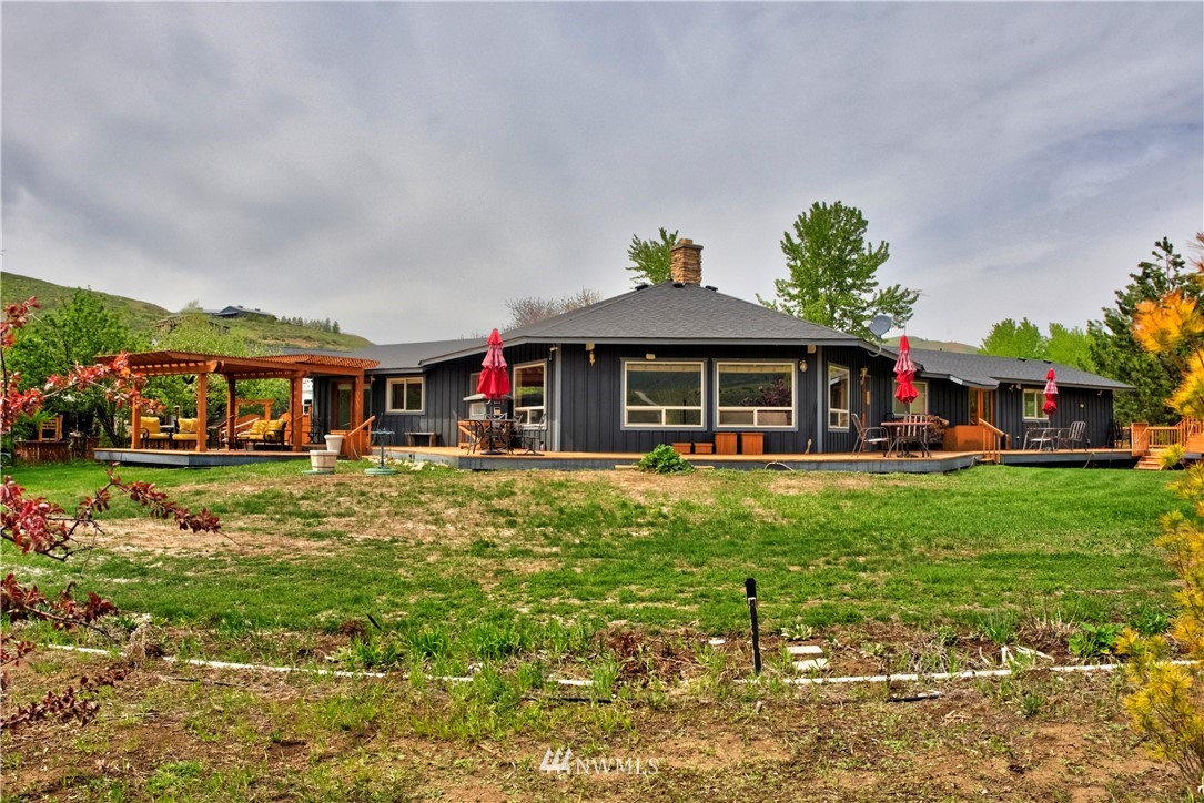WINTHROP-West Chewuch/Rendezvous:  Beautiful custom home on two tax parcels totaling 13.03 acres.  Single level, 4 BDRM, 3 BA home, (two master suites), open floor plan with fireplace as the centerpiece.   Great room concept with kitchen, dining and living-room combined, large slate fireplace as the center piece, vaulted ceilings, picture windows, wrap around deck, pergola, fenced yard, garage, 5-bay garage/shop/carports/green house and sweet seasonal guest cabin nestled in the aspen.  All just minutes from town yet so very private.  Year-round recreation opportunities our the door. Additional adjoining parcel available.