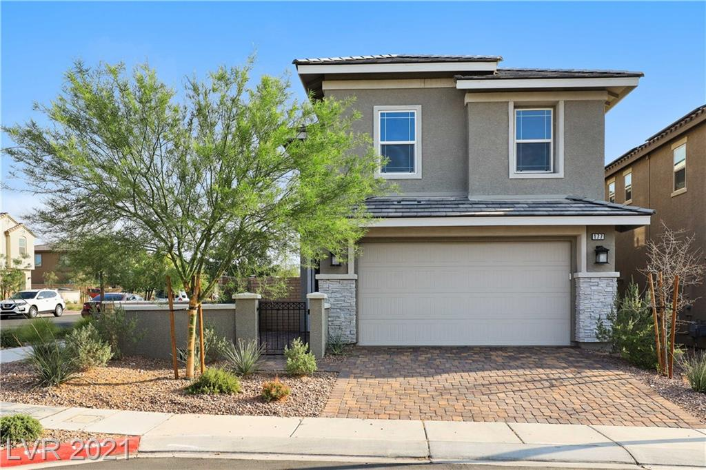 Almost new Cadence home w/strip views! Stunning two-story w/3BDRs & 2.5BTHs plus loft! Home is situated on a great corner lot w/nice courtyard entrance. Home is upgraded w/pleasing wood-like tile flooring running t/o the downstairs. Modern layout w/living area, dining area & kitchen combined. Open & bright kitchen features white cabinets, quartz countertops, trendy backsplash, island & breakfast bar combined w/3 stylish pendant lights, ss vent hood, ss appliances, built-in micro-wave, gas cooktop, built-in oven & recessed lighting. All of the bedrooms & loft are upstairs w/plush carpet. Spacious primary suite is elevated w/ceiling fan & walk-in closet & ensuite has dual sink vanity, quartz countertop, soaking tub & walk-in shower tiled to the ceiling. Backyard is complete w/covered patio running the width of the home. This is a must-see!
