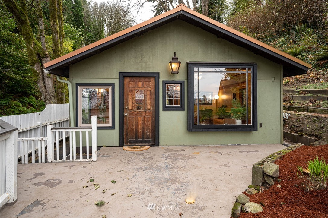 """Unique, charming & private northend cabin with iconic Pacific Northwest scenes of ferries, mountains & shipping lanes PLUS beach access! Detailed craftsman touches; built-ins, inlaid wood/fir flooring & ceiling. Windows & decks offer either nature or water views. Loft can sleep 3. Sewer connected. Delight in gull calls & the occasional fog horn. Full time, part time, vacation, commute, tele-commute...your choices abound! Island living with urban delights a """"stone's throw"""" away. Bring your kayak, paddle board, binoculars to bird or whale watch & enjoy the beautiful Puget Sound waters and beaches. This home offers much more than your eyes see from the street. Come on in & give it a go!"""