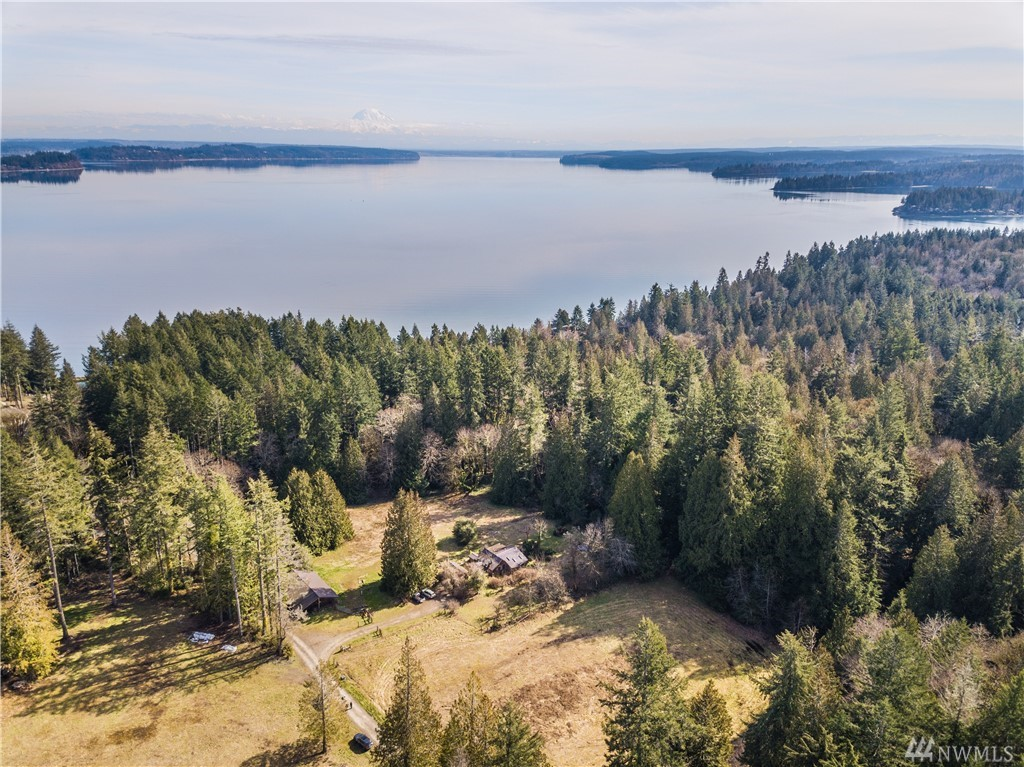 Rare opportunity to own over 20 acres with 3 homes & panoramic views of the sound from 2 of the properties. Over 400ft of medium bank waterfront - kayaking, boating, beach walks & hiking all in your back yard. Larger home on water has 4 beds 2.5 baths, 2nd home on water has 2 beds/2 baths & the small farm house nestled in the meadows has 2 beds/1bath. Tranquility at it's finest with mesmerizing sunrises & sunsets. This is truly a forever property, one you will enjoy for generations.